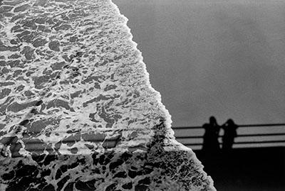 USA. Santa Monica, California. 1979. Shadows on sea and sand.